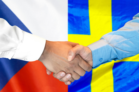 Business handshake on the background of two flags. Men handshake on the background of the Czech Republic and Sweden flag. Support concept