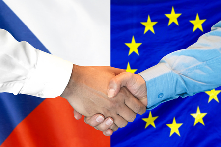 Business handshake on the background of two flags. Men handshake on the background of the Czech Republic and European Union flag. Support concept