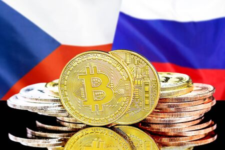 Concept for investors in cryptocurrency and Blockchain technology in the Czech Republic and Russia. Bitcoins on the background of the flag Czech Republic and Russia.