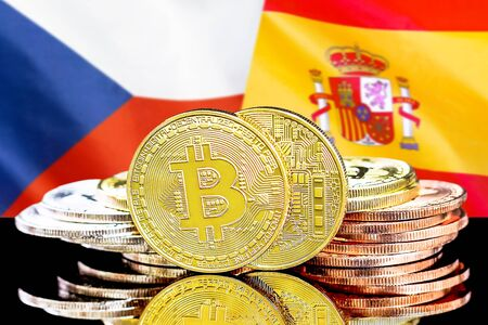 Concept for investors in cryptocurrency and Blockchain technology in the Czech Republic and Spain. Bitcoins on the background of the flag Czech Republic and Spain.