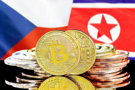 Concept for investors in cryptocurrency and Blockchain technology in the Czech Republic and North Korea. Bitcoins on the background of the flag Czech Republic and North Korea.