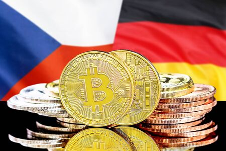 Concept for investors in cryptocurrency and Blockchain technology in the Czech Republic and Germany. Bitcoins on the background of the flag Czech Republic and Germany.