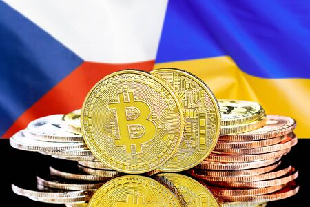 Concept for investors in cryptocurrency and Blockchain technology in the Czech Republic and Ukraine. Bitcoins on the background of the flag Czech Republic and Ukraine. Stock Photo