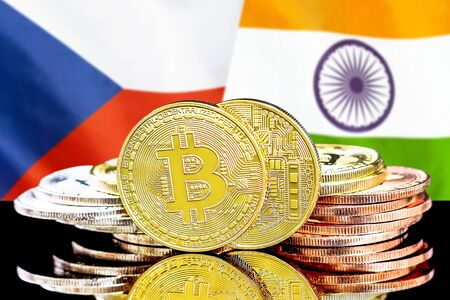 Concept for investors in cryptocurrency and Blockchain technology in the Czech Republic and India. Bitcoins on the background of the flag Czech Republic and India.