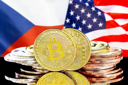 Concept for investors in cryptocurrency and Blockchain technology in the Czech Republic and United States of America. Bitcoins on the background of the flag Czech Republic and US. Stock Photo