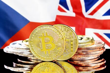 Concept for investors in cryptocurrency and Blockchain technology in the Czech Republic and United Kingdom. Bitcoins on the background of the flag Czech Republic and UK.