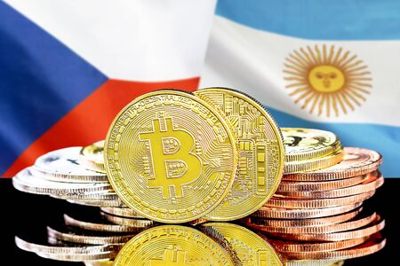 Concept for investors in cryptocurrency and Blockchain technology in the Czech Republic and Argentina. Bitcoins on the background of the flag Czech Republic and Argentina. Stock Photo