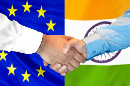 Business handshake on the background of two flags. Men handshake on the background of the European Union and India flag. Support concept