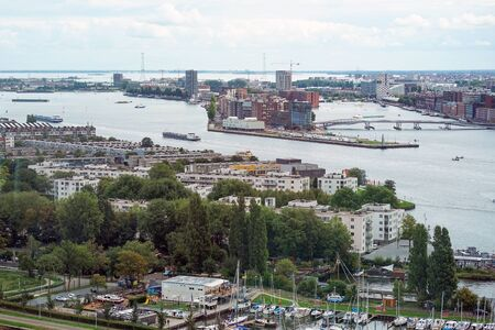 Aerial photo of Amsterdam city center showing Oosterdokseiland Dock Island which forms neighborhood just to the east of the central railway station. 31 August 2018. Amsterdam. Netherlands.