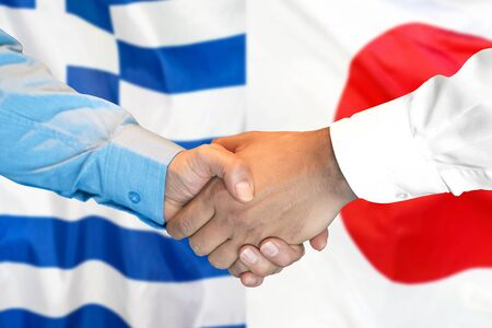 Business handshake on the background of two flags. Men handshake on the background of the Greece and Japan flag. Support concept