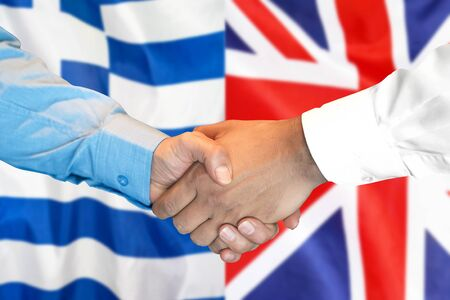 Business handshake on the background of two flags. Men handshake on the background of the Greece and United Kingdom flag. Support concept