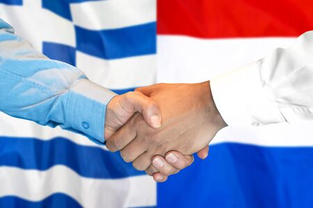 Business handshake on the background of two flags. Men handshake on the background of the Greece and Dutch flag. Support concept