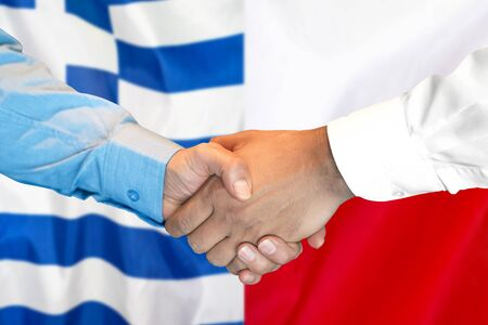 Business handshake on the background of two flags. Men handshake on the background of the Greece and Poland flag. Support concept