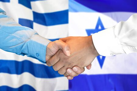 Business handshake on the background of two flags. Men handshake on the background of the Greece and Israel flag. Support concept