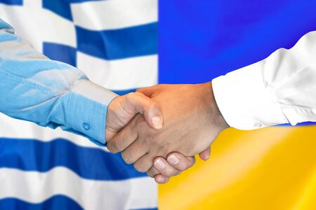 Business handshake on the background of two flags. Men handshake on the background of the Greece and Ukraine flag. Support concept Stock Photo