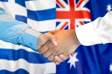Business handshake on the background of two flags. Men handshake on the background of the Greece and Australia flag. Support concept
