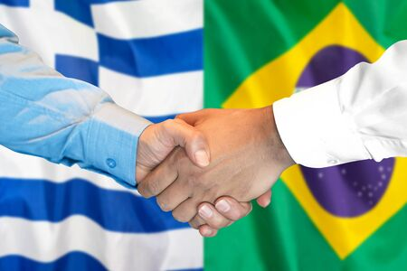 Business handshake on the background of two flags. Men handshake on the background of the Greece and Brazil flag. Support concept