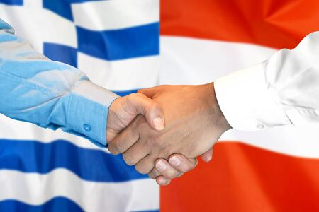 Business handshake on the background of two flags. Men handshake on the background of the Greece and Austria flag. Support concept