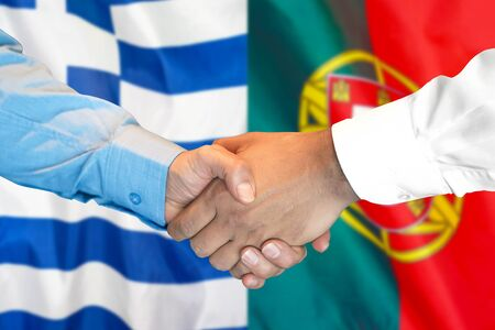 Business handshake on the background of two flags. Men handshake on the background of the Greece and Portugal flag. Support concept