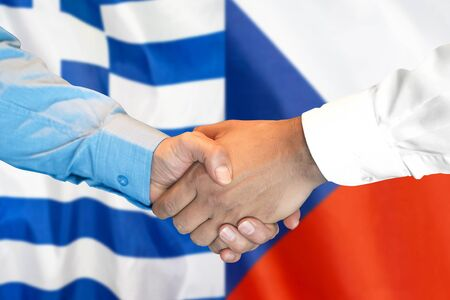 Business handshake on the background of two flags. Men handshake on the background of the Greece and Czech Republic flag. Support concept