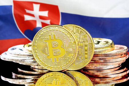 Concept for investors in cryptocurrency and Blockchain technology in the Slovakia. Bitcoins on the background of the flag Slovakia. Stock Photo