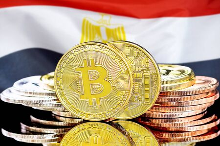 Concept for investors in cryptocurrency and Blockchain technology in the Egypt. Bitcoins on the background of the flag Egypt.