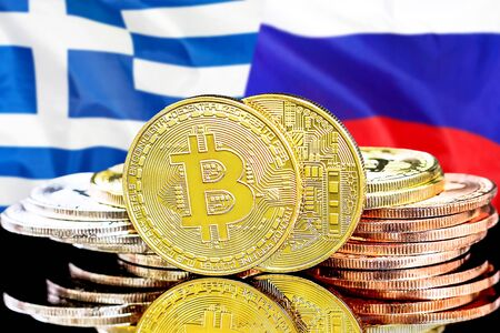 Concept for investors in cryptocurrency and Blockchain technology in the Greece and Russia. Bitcoins on the background of the flag Greece and Russia. Stock Photo