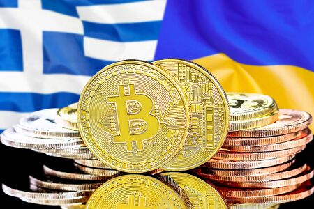 Concept for investors in cryptocurrency and Blockchain technology in the Greece and Ukraine. Bitcoins on the background of the flag Greece and Ukraine. Stock Photo