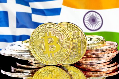 Concept for investors in cryptocurrency and Blockchain technology in the Greece and India. Bitcoins on the background of the flag Greece and India. Stock Photo