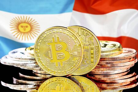 Bitcoins on the background of the flag Argentina and Austria. Concept for investors in cryptocurrency and Blockchain technology in the Argentina and Austria. Imagens