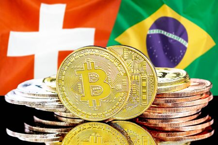 Concept for investors in cryptocurrency and Blockchain technology in the Switzerland and Brazil. Bitcoins on the background of the flag Switzerland and Brazil. Standard-Bild