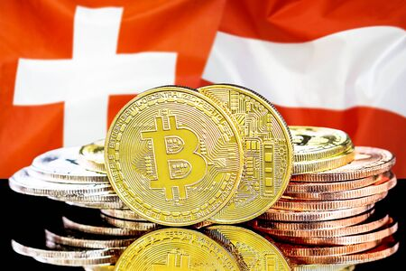 Concept for investors in cryptocurrency and Blockchain technology in the Switzerland and Austria. Bitcoins on the background of the flag Switzerland and Austria.