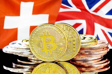 Concept for investors in cryptocurrency and Blockchain technology in the Switzerland and United Kingdom. Bitcoins on the background of the flag Switzerland and UK.