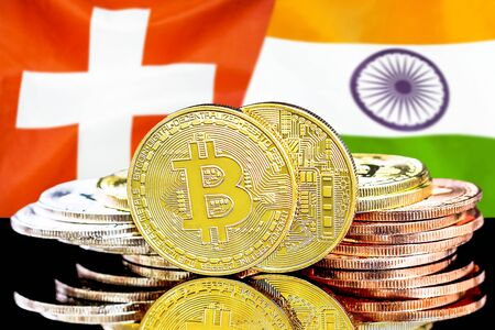 Concept for investors in cryptocurrency and Blockchain technology in the Switzerland and India. Bitcoins on the background of the flag Switzerland and India.
