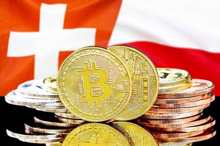 Concept for investors in cryptocurrency and Blockchain technology in the Switzerland and Poland. Bitcoins on the background of the flag Switzerland and Poland.