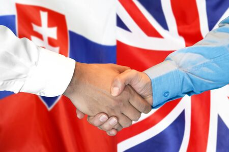 Business handshake on the background of two flags. Men handshake on the background of the Slovakia and United Kingdom flag. Support concept Stock fotó