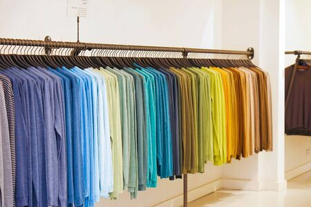 Fashionable clothing on hangers in shop. sport of T Shirts are hanging on Clothes Hanger , Colorful T Shirt. clothes hanger with t shirt.