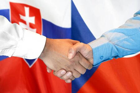 Business handshake on the background of two flags. Men handshake on the background of the Slovakia and Czech Republic flag. Support concept