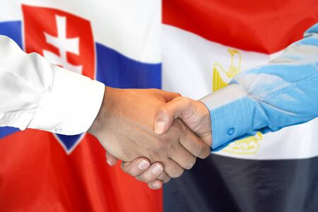 Business handshake on the background of two flags. Men handshake on the background of the Slovakia and Egypt flag. Support concept Stock fotó