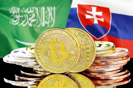 Concept for investors in cryptocurrency and Blockchain technology in the Saudi Arabia and Slovakia. Bitcoins on the background of the flag Saudi Arabia and Slovakia. Banque d'images