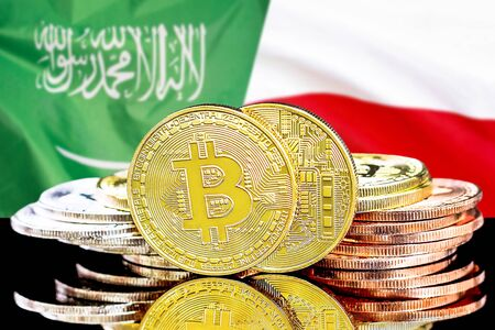Concept for investors in cryptocurrency and Blockchain technology in the Saudi Arabia and Poland. Bitcoins on the background of the flag Saudi Arabia and Poland.