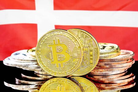 Concept for investors in cryptocurrency and Blockchain technology in the Denmark. Bitcoins on the background of the flag Denmark. Imagens
