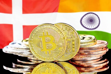 Concept for investors in cryptocurrency and Blockchain technology in the Denmark and India. Bitcoins on the background of the flag Denmark and India.