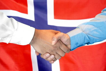 Business handshake on Norway flag background. Men shaking hands and Norway flag on background. Support concept