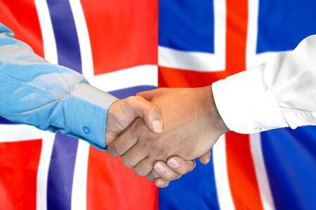 Business handshake on the background of two flags. Men handshake on the background of the Norway and Iceland flag. Support concept Banco de Imagens