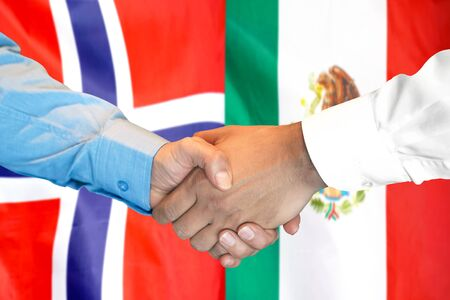 Business handshake on the background of two flags. Men handshake on the background of the Norway and Mexico flag. Support concept Banco de Imagens