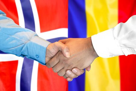 Business handshake on the background of two flags. Men handshake on the background of the Norway and Moldova flag. Support concept