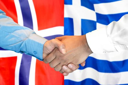 Business handshake on the background of two flags. Men handshake on the background of the Norway and Greece flag. Support concept