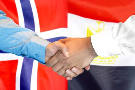 Business handshake on the background of two flags. Men handshake on the background of the Norway and Egypt flag. Support concept Banco de Imagens