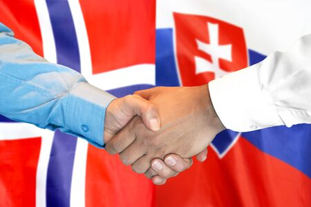 Business handshake on the background of two flags. Men handshake on the background of the Norway and Slovakia flag. Support concept